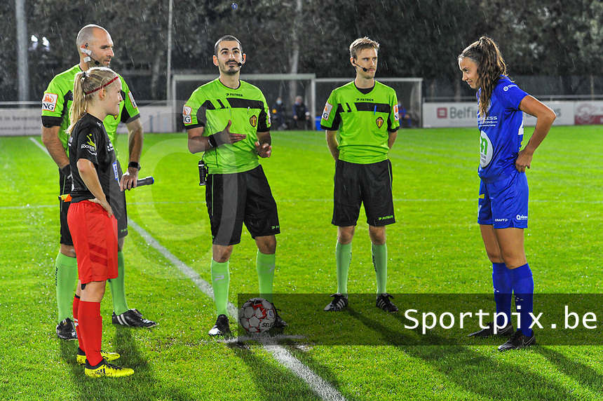 Assistant referee Sam Decroo , referee Ermaild Mataj , assistant referee Christophe Snoeck , Woluwe's midfielder Jana Simons (8) and Gent's defender Silke Vanwynsberghe (21)pictured during a female soccer game between  AA Gent Ladies and Femina White Star Woluwe on the third matchday of the 2020 - 2021 season of Belgian Scooore Womens Super League , friday 2 nd of October 2020  in Oostakker , Belgium . PHOTO SPORTPIX.BE | SPP | STIJN AUDOOREN