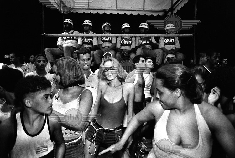 ©Dieter Telemans/Panos Pictures..Carnival in Salvador Bahia, Brazil..When finally the official carnival starts, things really get organised. Huge stands are built, a ten thousand man strong police and army force appear in the streets, and even more street vendors who carry whatever they can hold bravely among and between spectators and blocos or trio elétricos. Photo:  Dieter Telemans / Panos Pictures/Felix Features