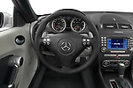 Straight angle streering wheel view of a Mercedes Benz SLK Class sports car