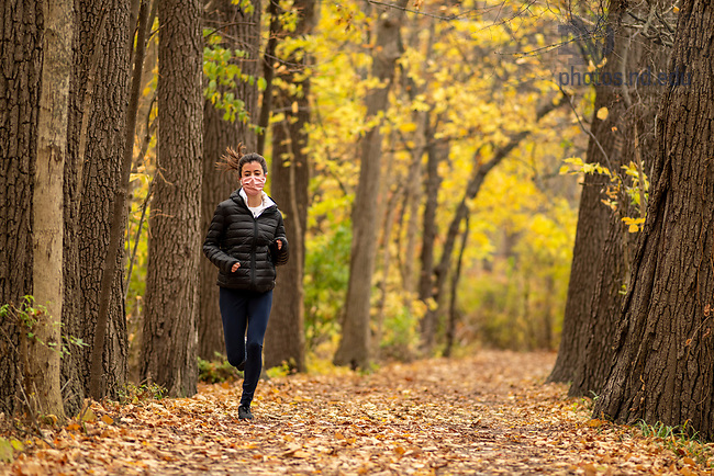 October 30, 2020; A student jogs on the trail around St. Joseph Lake. (Photo by Barbara Johnston/University of Notre Dame)