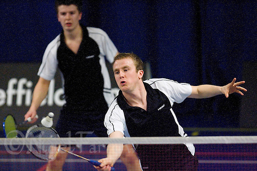 15 MAR 2008 - SHEFFIELD, UK -  Tom Armstrong (Loughborough University) returns watched by doubles partner Grant Weir - BUSA Championship Semi Final. (PHOTO (C) NIGEL FARROW)