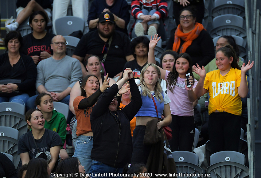 Fans compete for marketing material during the Cadbury Netball Series match between NZ A and NZ Under-21 at the Fly Palmy Arena in Palmerston North, New Zealand on Thursday, 22 October 2020. Photo: Dave Lintott / lintottphoto.co.nz