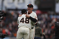 SAN FRANCISCO, CA - APRIL 5:  Manager Bruce Bochy #15 of the San Francisco Giants hugs Pablo Sandoval #48 during pregame ceremonies on the field before the game against the Tampa Bay Rays at Oracle Park on Friday, April 5, 2019 in San Francisco, California. (Photo by Brad Mangin)