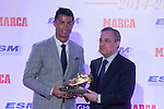 Real Madrid´s Cristiano Ronaldo (L) receives the 2014-15 Golden Boot award from Real Madrid´s President Florentino Perez in Madrid, Spain. October 13, 2015. (ALTERPHOTOS/Victor Blanco)