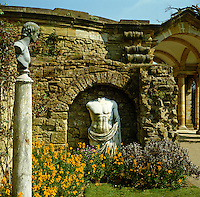 A marble torso and a bust on a pedestal in the classical Italian garden at Hever Castle