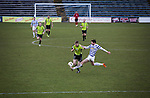 Greenock Morton 2 Stranraer 0, 21/02/2015. Cappielow Park, Greenock. Action from the second-half as Greenock Morton (in hoops) defend against Stranraer in a Scottish League One match at Cappielow Park, Greenock. The match was between the top two teams in Scotland's third tier, with Morton winning by two goals to nil. The attendance was 1,921, above average for Morton's games during the 2014-15 season so far. Photo by Colin McPherson.