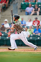 Arkansas Travelers first baseman Kyle Waldrop (10) follows through on a swing during a game against the Frisco RoughRiders on May 28, 2017 at Dickey-Stephens Park in Little Rock, Arkansas.  Arkansas defeated Frisco 17-3.  (Mike Janes/Four Seam Images)