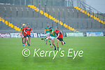 Raymond Galin of Lixnaw kick passes the sliotar away as Ballyheigue's Michael Leane applies pressure on him, in Round 2 of the County Senior Hurling championship,