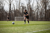 LOUISVILLE, KY - MARCH 13: Emily Fox #11 of Racing Louisville FC chases down the ball during a game between West Virginia University and Racing Louisville FC at Thurman Hutchins Park on March 13, 2021 in Louisville, Kentucky.