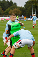 Mat Eliet of London Scottish helps with the warm up during the Championship Cup match between London Scottish Football Club and Nottingham Rugby at Richmond Athletic Ground, Richmond, United Kingdom on 28 September 2019. Photo by Carlton Myrie / PRiME Media Images