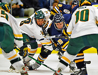 16 November 2008: University of Vermont Catamount forward and Team Captain Dean Strong, a Senior from Mississauga, Ontario, battles Merrimack College Warriors' forward Kurtis Astle, a Sophomore from Port Coquitlam, B.C., at Gutterson Fieldhouse, in Burlington, Vermont. The Catamounts defeated the Warriors 2-1 in front of a near-capacity crowd of 3,813...Mandatory Photo Credit: Ed Wolfstein Photo