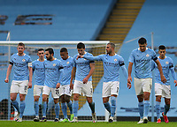 10th January 2021; Etihad Stadium, Manchester, Lancashire, England; English FA Cup Football, Manchester City versus Birmingham City; Phil Foden of Manchester City celebrates with his team mates after scoring his side's third goal after 33 minutes