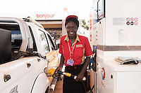 N. Uganda, Kitgum District. Peter C. Alderman Foundation project. Woman attendant pumping gas,
