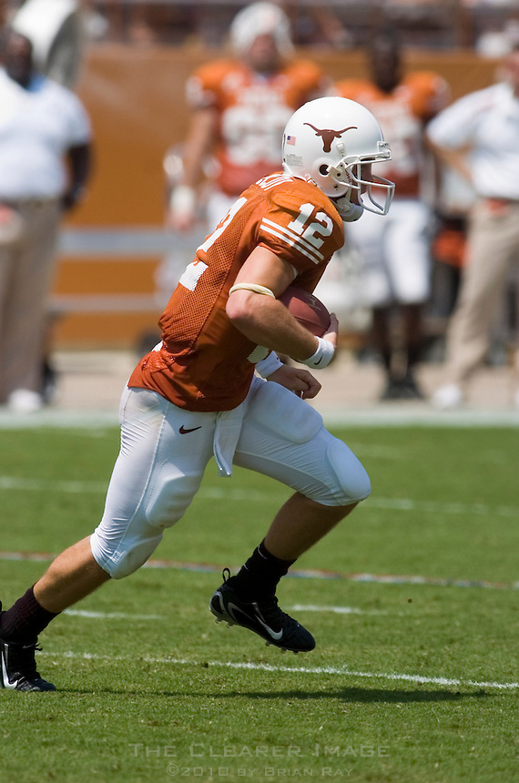 02 September 2006: University of Texas quarterback Colt McCoy dashes down field during the first half of the Longhorns game against the University of North Texas at Darrell K Royal Stadium in Austin, TX.