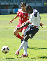 Freddy Adu kicks as Abdallah Shahat looks on. The USA defeated Egypt 1-0 at the FIFA World Youth Championships at Arke Stadion, Enschede, Netherlands on June 18, 2005..