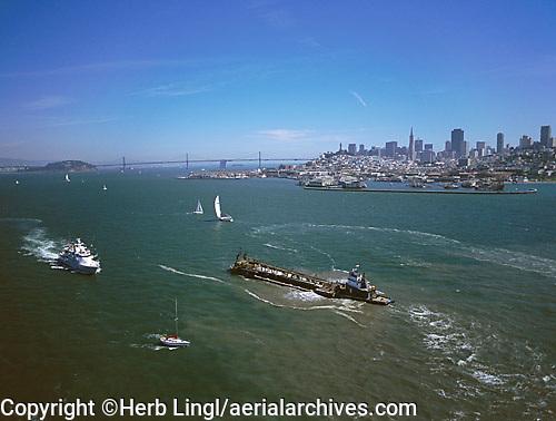 aerial photograph barge, ferry, sailboats, skyline San Francisco, California