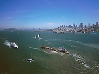 aerial photograph barge, ferry, sailboats, skyline San Francisco, California