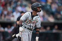 Liover Peguero (10) of the Greensboro Grasshoppers hustles down the first base line against the Winston-Salem Dash at Truist Stadium on June 19, 2021 in Winston-Salem, North Carolina. (Brian Westerholt/Four Seam Images)