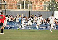 Uche Oteqbeye #9 of Georgetown University after scoring the golden goal during an NCAA match against Northeastern University at North Kehoe Field, Georgetown University on September 3 2010 in Washington D.C. Georgetown won 2-1 AET.