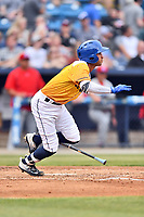 Beer City Tourists shortstop Carlos Herrera (2) lays down bunt during a game against the Lakewood BlueClaws at McCormick Field on June 1, 2017 in Asheville, North Carolina. The Tourists defeated the BlueClaws 8-5. (Tony Farlow/Four Seam Images)