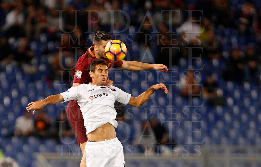 Calcio, Serie A: Roma vs Palermo. Roma, stadio Olimpico, 23 ottobre 2016.<br /> Roma's Kostas Manolas, top, and Palermo's Ivaylo Chochev jump for the ball during the Italian Serie A football match between Roma and Palermo at Rome's Olympic stadium, 23 October 2016. Roma won 4-1.<br /> UPDATE IMAGES PRESS/Riccardo De Luca