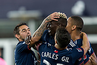 FOXBOROUGH, MA - AUGUST 24: Wilfried Zahibo #23 of New England Revolution celebrates his goal with teammates during a game between Chicago Fire and New England Revolution at Gillette Stadium on August 24, 2019 in Foxborough, Massachusetts.