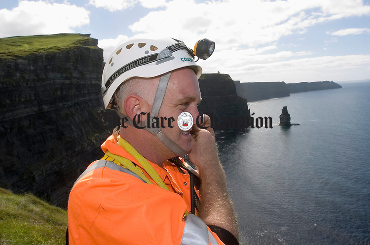 Bernard Lucas ready's himself for a cliff descent during the Technical Advisory Commission Cliff Rescue Assessment at the cliffs of Moher. Photograph by John Kelly.