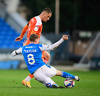 Blackpool's Jerry Yates vies for possession with Peterborough United's Jack Taylor<br /> <br /> Photographer Chris Vaughan/CameraSport<br /> <br /> The EFL Sky Bet League One - Peterborough United v Blackpool - Saturday 21st November 2020 - London Road Stadium - Peterborough<br /> <br /> World Copyright © 2020 CameraSport. All rights reserved. 43 Linden Ave. Countesthorpe. Leicester. England. LE8 5PG - Tel: +44 (0) 116 277 4147 - admin@camerasport.com - www.camerasport.com