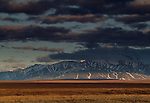 Dark clouds stretch over the Brooks Range and the arctic plains.