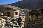 Ladakhi woman outside her home. High valley in the Himalayas. Ladakh, northern India.