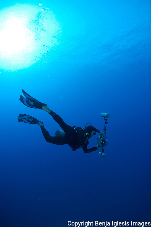 Photographer swimming in the open ocean, Hawaii.