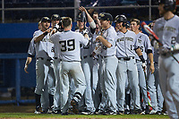Ben Breazeale (39) of the Wake Forest Demon Deacons is greeted by his teammates as he returns to the dugout after hitting a home run against the Florida Gators in Game One of the Gainesville Super Regional of the 2017 College World Series at Alfred McKethan Stadium at Perry Field on June 10, 2017 in Gainesville, Florida. The Gators defeated the Demon Deacons 2-1 in 11 innings. (Brian Westerholt/Four Seam Images)