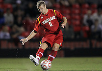 COLLEGE PARK, MD. - AUGUST 20, 2012:  Helge Leikvang (6) of  the University of Maryland makes a pass against Penn State during an NCAA match at Ludwig Field, in College Park, Maryland on August 20. The game ended in a 2-2 tie.
