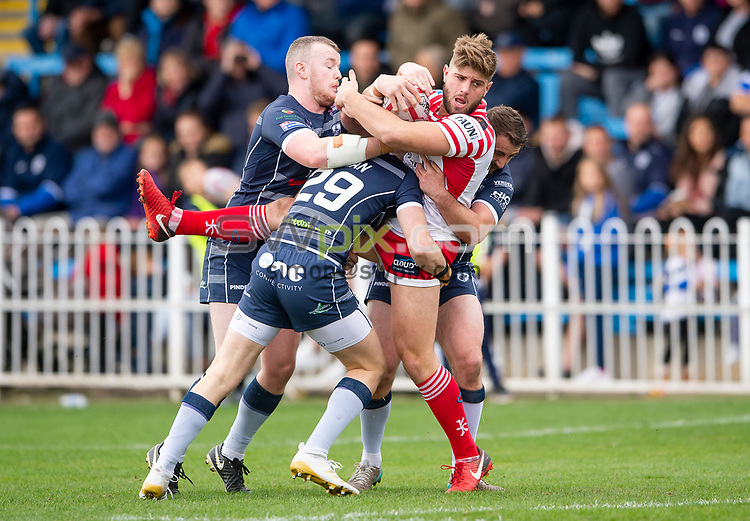 Picture by Allan McKenzie/SWpix.com - 07/10/2018 - Rugby League - Betfred Championship Shield Super 8's Final - Featherstone Rovers v Leigh Centurions - LD Nutrition Stadium, Featherstone, England - Leigh's Nicholas Gregson is tackeld by Featherstone's Harry Newman & Martyn Ridyard.