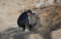 Pictured: A special forensics police officer searches in a field in Kos, Greece. Tuesday 04 October 2016<br /> Re: Police teams led by South Yorkshire Police, searching for missing toddler Ben Needham on the Greek island of Kos have moved to a new area in the field they are searching.<br /> Ben, from Sheffield, was 21 months old when he disappeared on 24 July 1991 during a family holiday.<br /> Digging has begun at a new site after a fresh line of inquiry suggested he could have been crushed by a digger.