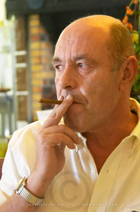 Jean-Noël Bousquet with cigar. Chateau Grand Moulin. In Lezignan-Corbieres. Les Corbieres. Languedoc. Owner winemaker. France. Europe.