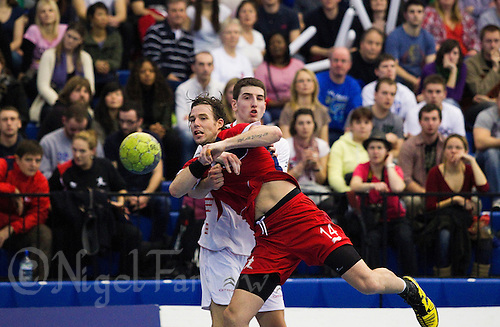 08 JAN 2012 - LONDON, GBR - Great Britain right back Steve Larsson (#14, in red) shoots during the men's 2013 World Handball Championships qualification match against Austria at the National Sports Centre in Crystal Palace, Great Britain .(PHOTO (C) 2012 NIGEL FARROW)