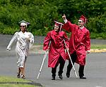 Wolcott, CT- 13 June 2016-061316CM07-  Wolcott High School graduates Rebecca Secula, Nick Garcia and Alex Wabuda celebrate before the start of commencement exercises on Monday.    Christopher Massa Republican-American