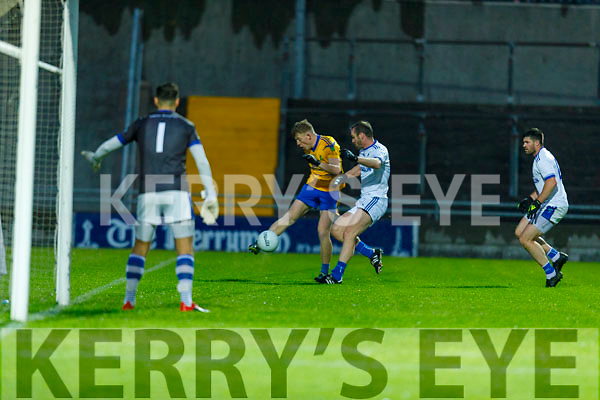 Evan Cronin of Spa about to shoot across the small square despite the attention from Laune Rangers Kieran Crowley  in the Intermediate Football Championship Quarter final.