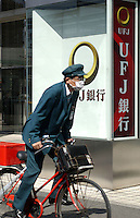 Businessman passes in front of the UFJ bank in Tokyo  banking and business district called Otemachi..