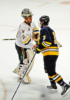 16 November 2008: University of Vermont Catamount goaltender Mike Spillane (left), a Junior from Bow, NH, shakes hands with members of the Merrimack College Warriors at Gutterson Fieldhouse in Burlington, Vermont. The Catamounts defeated the Warriors 2-1 in Hockey East play...Mandatory Photo Credit: Ed Wolfstein Photo