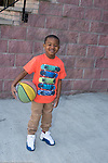 5 year old boy outside portrait with basketball full length