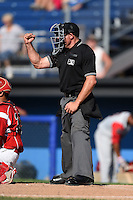 Umpire Christopher Stump makes a call during a game between the Williamsport Crosscutters and Batavia Muckdogs on July 27, 2014 at Dwyer Stadium in Batavia, New York.  Batavia defeated Williamsport 6-5.  (Mike Janes/Four Seam Images)