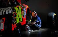 Feb 07, 2009; Daytona Beach, FL, USA; A crew member for NASCAR Sprint Cup Series driver Jeff Gordon (not pictured) works on the car in the garage during practice for the Daytona 500 at Daytona International Speedway. Mandatory Credit: Mark J. Rebilas-