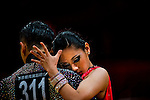 Kwan-Ho Ma and Tsz-Ching Huen of Hong Kong during the WDSF GrandSlam Standard on the Day 2 of the WDSF GrandSlam Hong Kong 2014 on June 01, 2014 at the Queen Elizabeth Stadium Arena in Hong Kong, China. Photo by AItor Alcalde / Power Sport Images