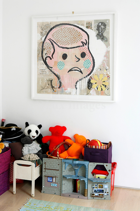 Mr. Rosenberg and his wife live in the heart of Soho in NewYork, and their home faces the numerous old water tanks of the West Village.  He works in finance and she imports children's furniture from Europe.