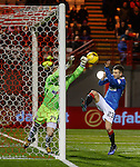 Hamilton keeper Gary Woods just punches clear from Jason Holt