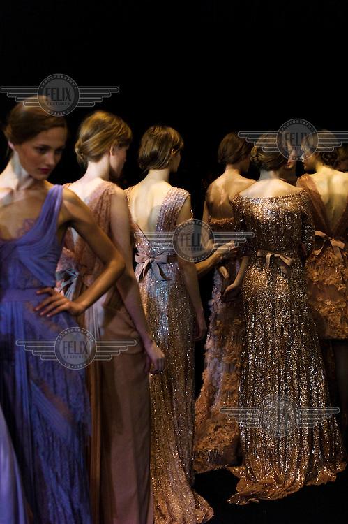 Models waiting backstage at the Elie Saab fashion show during Paris Fashion Week.