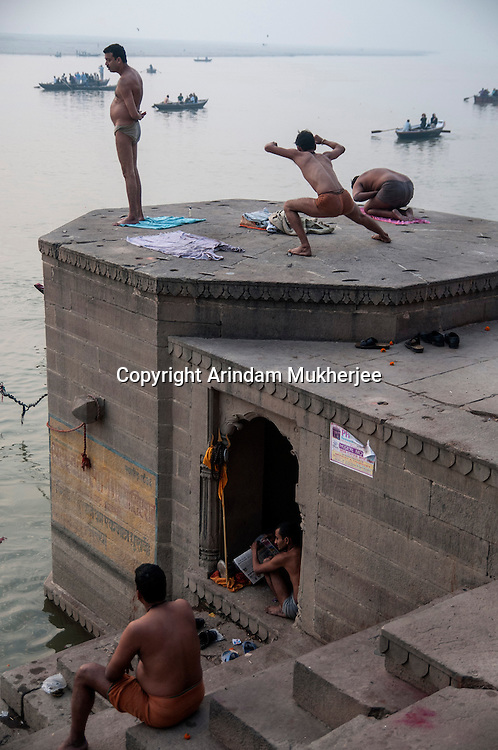 People works out in the morning at a ghat in Varanasi, Uttar Pradesh, India.