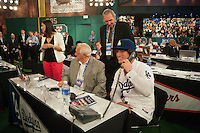 Pitcher Grant Holmes (Conway H.S. (SC)) the number 22 overall pick to the Los Angeles Dodgers with Hall of Famer Tommy Lasorda and former Dodgers pitcher Charlie Hough during the MLB Draft on Thursday June 05,2014 at Studio 42 in Secaucus, NJ.   (Tomasso DeRosa/ Four Seam Images)